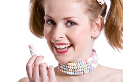 Candy girl. Pretty blond girl with gorgeous smile on white background Royalty Free Stock Image