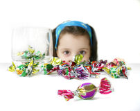 Candy girl. Little girl looking at a bunch of colorful candies Royalty Free Stock Photo