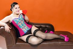 Candy Girl on Chaiselongue Stock Images
