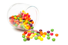 Candy in a glass jar. On white background Stock Images