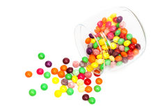 Candy in a glass jar. On white background stock photography