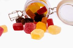 Candy in a glass jar,. Candy in a glass jar on white background, A glass jar full of candies isolated on white stock images