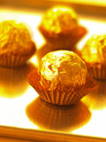 Candy in gold wrapper Royalty Free Stock Photos