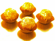 Candy in gold wrapper Royalty Free Stock Photo