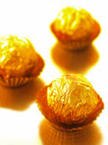 Candy in gold wrapper Royalty Free Stock Photography
