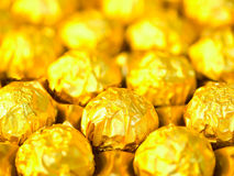 Candy in gold wrappers Royalty Free Stock Photography