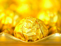 Candy in gold wrappers Royalty Free Stock Images
