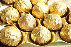 Candy in golden foil Stock Images