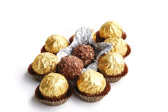 Candy in golden foil. Over white background stock photo