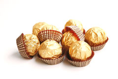 Candy in golden foil Stock Photos