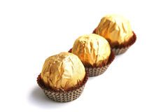 Candy in golden foil Stock Image