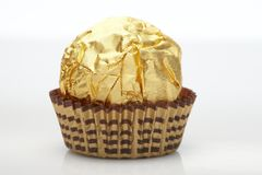 Candy in golden foil Royalty Free Stock Photography