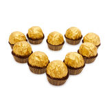 Candy in golden foil in the shape of a heart Royalty Free Stock Photo