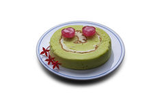 Candy on green roll cake, smile face. Royalty Free Stock Image