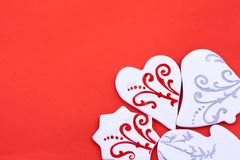 Candy greeting card. Different shaped candies on the red background Royalty Free Stock Images