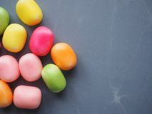 Candy on grey background. Candy grey background marble treat teeth dental unhealthy diet sweet easter group colour bright diabetes obesity sugar dietary royalty free stock photography