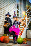 Candy on halloween. Happy children in a costumes of witches and wizards celebrating halloween. Trick or treat. Halloween party Stock Image