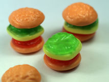 Candy hamburger. Three candy hamburger composition on a white background royalty free stock photo