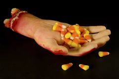 Candy in hand Stock Photography