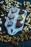 Candy handmade. Sweets without sugar from dried fruits and nuts. Proper nutrition. An assortment of nuts. View from above stock photos
