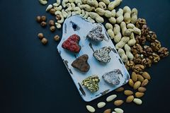 Candy handmade. Sweets without sugar from dried fruits and nuts. Proper nutrition. An assortment of nuts. View from above stock photo