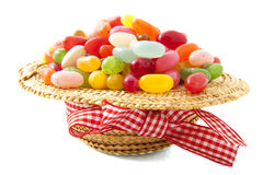 Candy hat. Hat filled with jelly beans over white stock photo