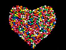 Candy Heart. Hundreds and thousands candy in heart shape isolated on black background Stock Image