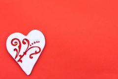 Candy heart greeting card. White heart-shaped candy on the red background Royalty Free Stock Photo