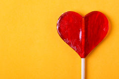 Candy heart. One candy heart shape on yellow background Royalty Free Stock Images