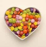 Candy in heart shaped bowl Royalty Free Stock Image