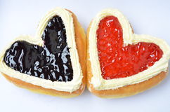 Candy heart shaped donuts. Stock Photos