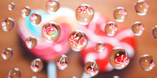 Candy heart shaped picture in water drops Royalty Free Stock Photos