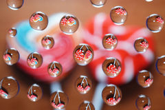 Candy heart shaped picture in water drops Stock Photography