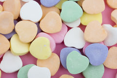 Candy Hearts. Multi color candy hearts on a pink background royalty free stock photos