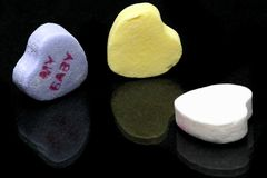 Candy Hearts. Candy message hearts on a black background royalty free stock image