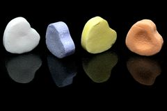 Candy Hearts. Candy message hearts on a black background royalty free stock photography