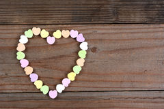 Candy Hearts Arranged in Heart Shape Stock Images