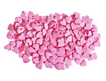 Candy hearts. Color candy hearts on a pink background stock photo
