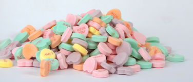 Candy Hearts. Colorful candy hearts on a white background stock photo