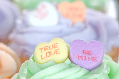 Candy Hearts on Cupcakes Stock Images