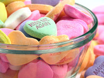 Candy Hearts In A Dish. One says 'Kiss Me Again stock photography