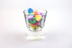 Candy hearts in a glass stock image