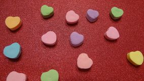 Candy hearts on a glitter background royalty free stock photography