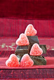 Candy Hearts on a Pile of Dark Chocolate Pieces Stock Photos