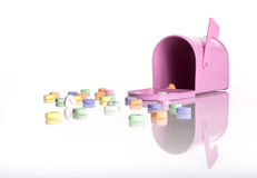 Candy hearts and pink mailbox Stock Photo