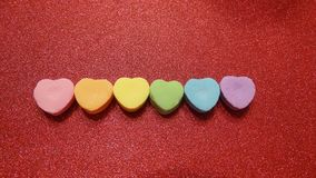 Candy hearts on a red background royalty free stock images