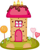 Candy house. Fantasy candy house on a meadow with candies, cookies and chocolate cream Royalty Free Stock Image