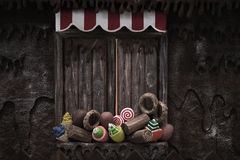 Candy House. Various fake cupcakes, candy, doughnuts, and ice cream cones decoration on wooden window ledge stock photos