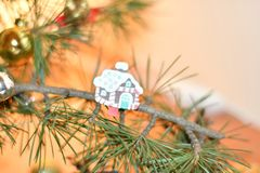 Candy house. Christmas decoration. Pine tree with small ornament royalty free stock image