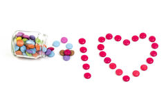 Candy Jar. Colored candy, in a glass jar, on white background, form the text: I LOVE stock images